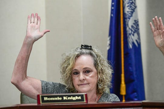 Bonnie Knight votes in approval of ending the Anderson County School District 2 meeting at the district office in Honea Path Monday, June 17, 2019.