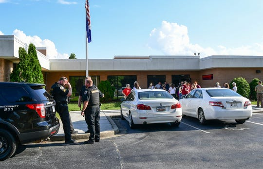 Sheriff's deputies stand outside after an Anderson County School District 2 special-called meeting at the district office in Honea Path Monday, June 17, 2019.