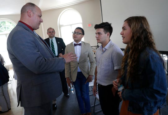 "Rep. Jesse James (R-Altoona) speaks with Alex Hart-Upendo, TJ Esser and Barrett Poetker after a screening of ""You're Not Alone,"" a documentary about youth mental health, Monday at Ripon College."