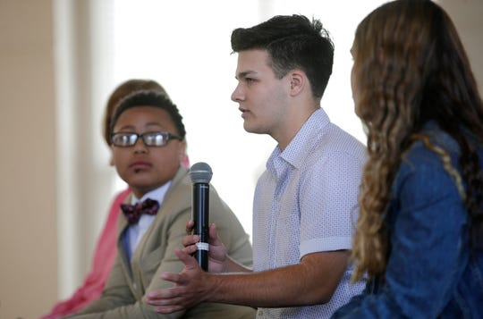 """TJ Esser answers questions after a screening of """"You're Not Alone"""" with Alex Hart-Upendo and Barrett Poetker Monday at Ripon College. The screening was part of a public hearing for the Speaker's Task Force on Suicide Prevention."""