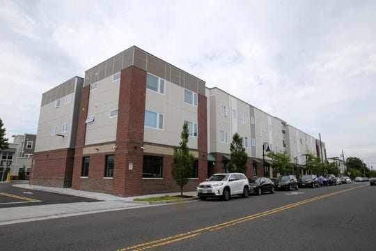Exterior of one of the three buildings during the grand opening of The Renaissance, a new development of 64 apartments affordable to working families along with retail space in the Springwood Avenue neighborhood, financed in part by NJHMFA, in Asbury Park, NJ Monday June 17, 2019.