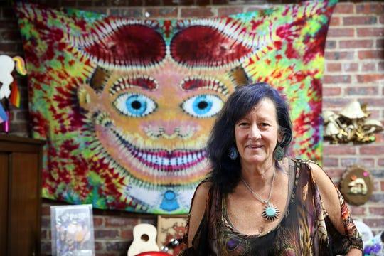 Melinda Murat-Blevins, co-owner of Type B Tie Dye Asbury Park, displays some of her tie dye items at the Type B Tie Dye location in Asbury Park, NJ Monday June 17, 2019.
