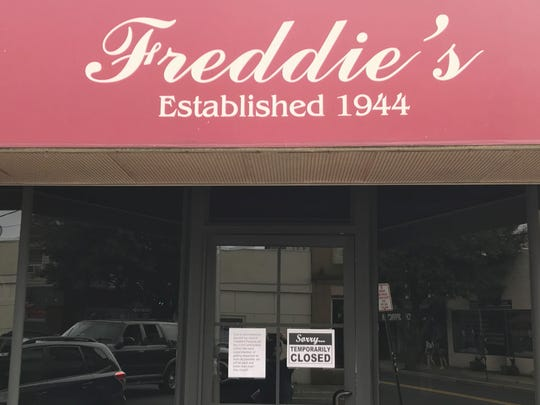 A sign on Freddie's Restaurant and Pizzeria in Long Branch tells customer's the business is temporarily closed.