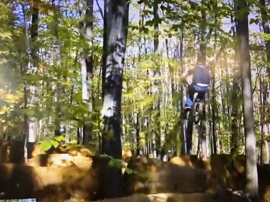 A BMX rider flies through the air on Radiation Trails in Holmdel as pictured in a 2010 video