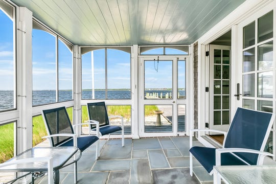 The home offers a custom screen porch with tile flooring.