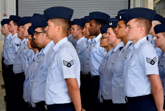 """The diversity of the United States Air Force is reflected by a formation of 7th Bomb Wing airmen during Monday's change of command ceremony at Dyess Air Force Base. Col. Jose """"Ed"""" Sumangil assumed command of the wing, a naturalized citizen born in the Philippines. He took over from Col. Brandon Parker, the base's first African-American commander."""