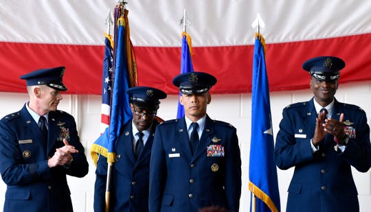 "Air Force Maj. Gen. James Dawkins Jr. (left) and Col. Brandon Parker (right) applaud Monday after Col. Jose ""Ed"" Sumangil assumed command of the 7th Bomb Wing at Dyess Air Force Base."