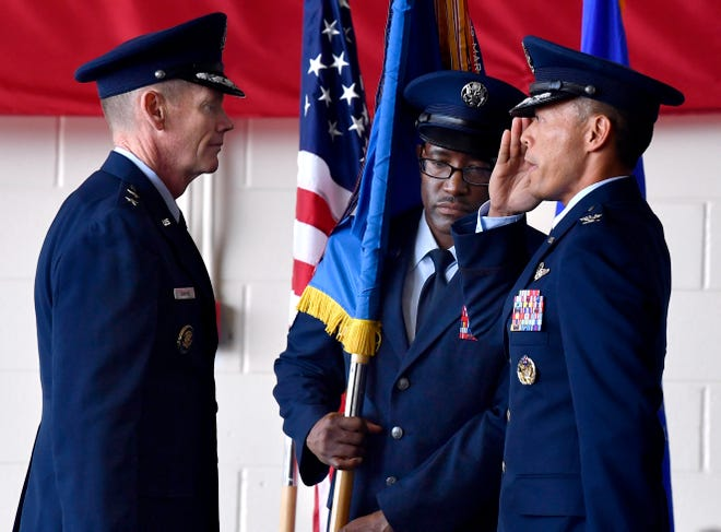 Chief Master Sgt. Eric Dugger, center, the 7th Bomb Wing command chief, held the unit's guidon at the June command change at Dyess Air Force Base that put Col. Ed Sumangil, right, in command of the base.