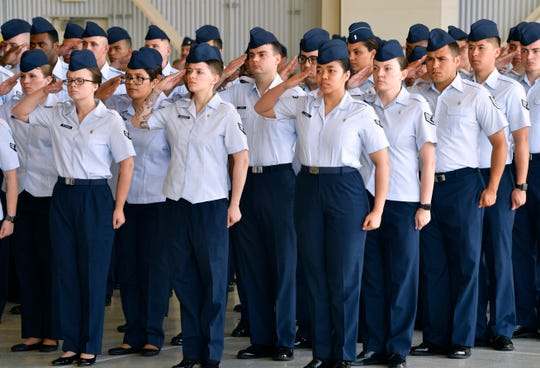 "Members of the 7th Bomb Wing salute their new commander, Col. Jose ""Ed"" Sumangil, after he assumed command of the wing from Col. Brandon Parker during Monday's change of command ceremony at Dyess Air Force Base."