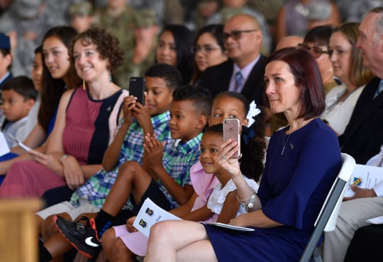 "Alison Parker listens as her husband, Col. Brandon Parker, acknowledges the support of her and their children during Monday's 7th Bomb Wing change of command ceremony at Dyess Air Force Base. Col. Jose ""Ed"" Sumangil assumed command of the wing from Parker."