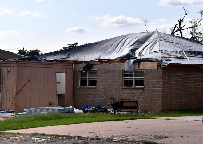 Plastic covers the roof of a South 6th Street home June 12, 2019, the victim of the May 18, EF-2 tornado that stuck Abilene.