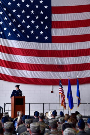 """Col. Jose """"Ed"""" Sumangil addresses the audience and members of the 7th Bomb Wing after assuming command of the unit from Col. Brandon Parker on June 17.. The change of command marks Sumangil's return to Dyess Air Force Base."""