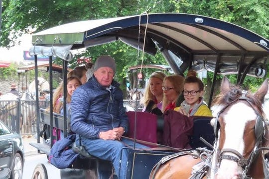 Members of Chorus Abilene ride a jaunting car to Killarney National Park in Ireland.