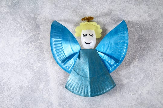 Students can use a plastic spoon, paper plate and markers to create an angel decoration for their teacher. Another option is creating a butterfly.
