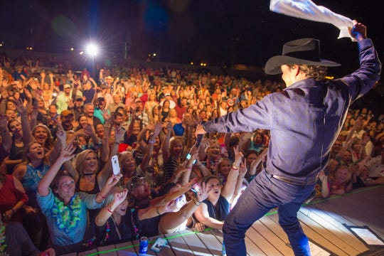 Clay Walker whips up a crowd during one of the 80 to 100 concerts he plays each year.