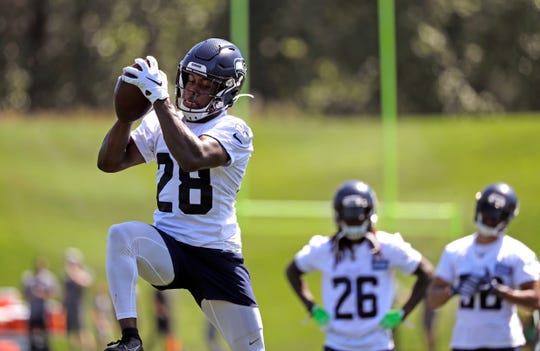 Seattle Seahawks' Ugo Amadi catches a ball during a minicamp workout June 13. Amadi is one of two rookies competing with Tedric Thompson and Lano Hill for Seattle's open safety position.