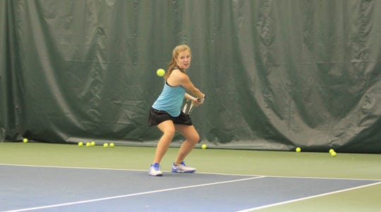 Anna Sobol lines up a backhand during lessons with Bo Webb at Creekside Racquet Club, where the rising junior at Owen High School is returning to the tennis court after suffering a torn ACL last September.