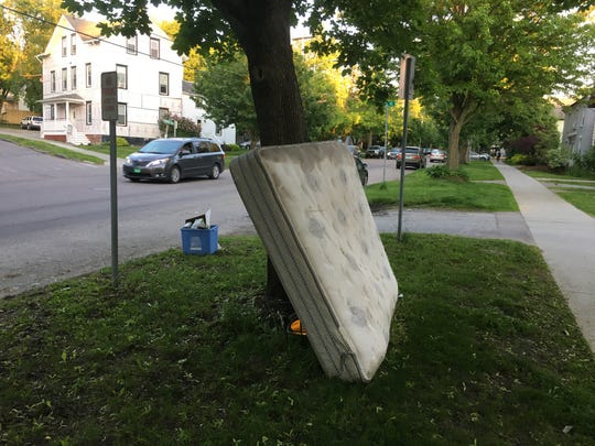 A discarded mattress is up for grabs (or disposal) on St. Paul Street in Burlington on June 7, 2019.