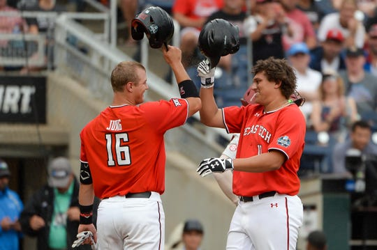Jun 17, 2019; Omaha, NE, USA; Texas Tech Red Raiders infielder Cameron Warren (11) celebrates with infielder Josh Jung (16) after hitting a home run in the fourth inning against the Arkansas Razorbacks in the 2019 College World Series at TD Ameritrade Park. Mandatory Credit: Steven Branscombe-USA TODAY Sports