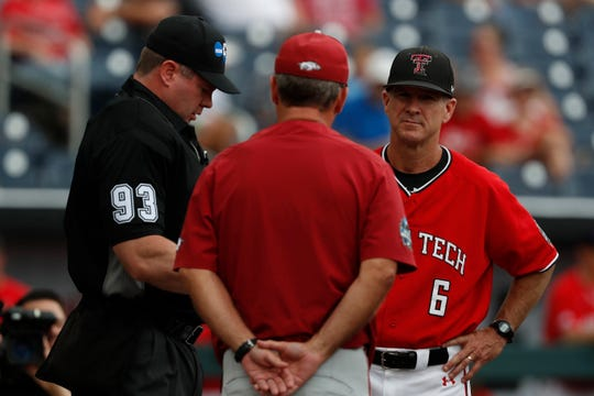 Jun 17, 2019; Omaha, NE, USA; Arkansas Razorbacks head coach Dave Van Horn and Texas Tech Red Raiders head coach Tim Tadlock meet with home plate umpire Adan Dowdy prior to the game in the 2019 College World Series at TD Ameritrade Park . Mandatory Credit: Bruce Thorson-USA TODAY Sports