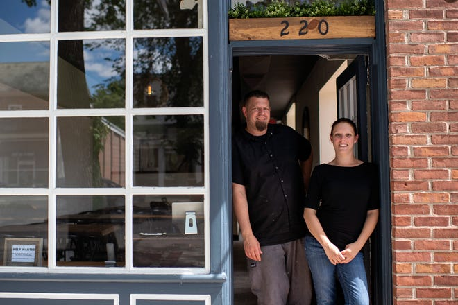 Owners Mike Stollenwerk, left, and Felice Leibowitz  stand in the doorway of The Little Hen in Haddonfield.