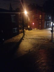 Storms turned Lewis Street into a gushing river around 2 a.m. June 16 in Covington.