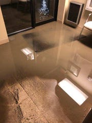 Ludlow Police Department Chief Scott Smith photographed water in the process of receding from the police station in the city building's lower level.