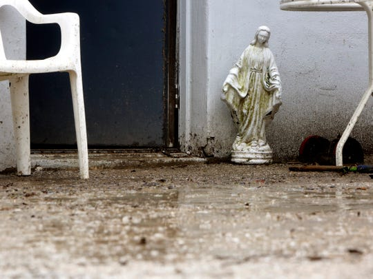 A statue of the Virgin Mary was washed down Lewis Street and into the garage of SI Enterprises. The owners, Sharon and Sam Ionna, said they didn't know where it came from, but set it up outside the door as they cleaned up.