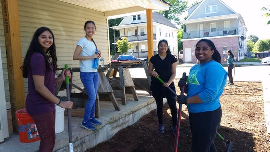 Sanjna Patel of Edison, Nicole Kimm of Watchung, Pooja Nandhyala of Edison and Sreeja Arumilli of Edison help maintain a property.