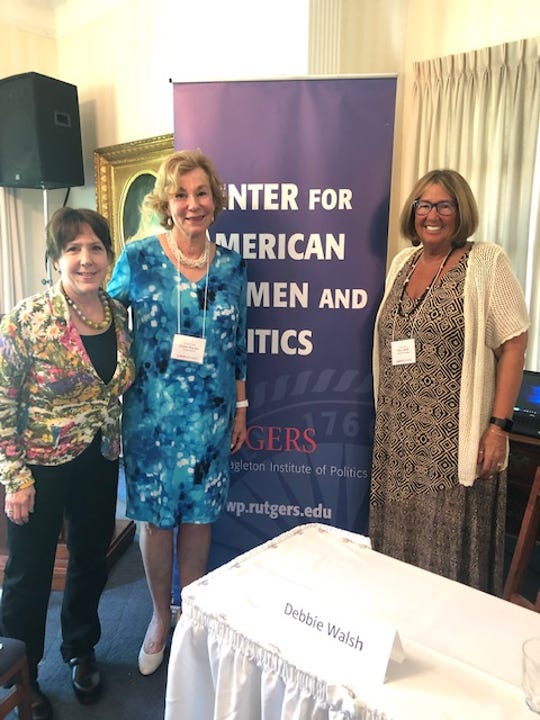 CAWP Director Debbie Walsh, at left, welcomes Union County Clerk Joanne Rajoppi and Hunterdon County Clerk Mary Melfi to a panel discussion on the news laws governing voting in  New Jersey.