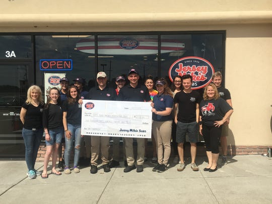 Raritan  Jersey Mike's owner Joe Williams, and his staff along with Michael Mucci, manager of the Bernardsville location, presented a $2,312 check to BPA co-presidents, AnnaRené Jeremiah and Anna Rooney, along with several student members of the BR Band Program at the Raritan store on June 15.