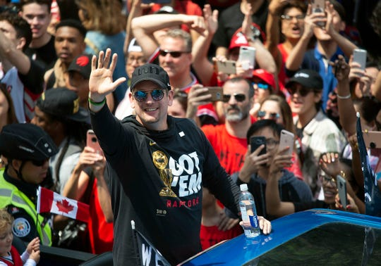 Toronto Raptors head coach Nick Nurse waves to the crowd during the Toronto Raptors championship parade on June 17, 2019, in Toronto, Ontario, Canada.