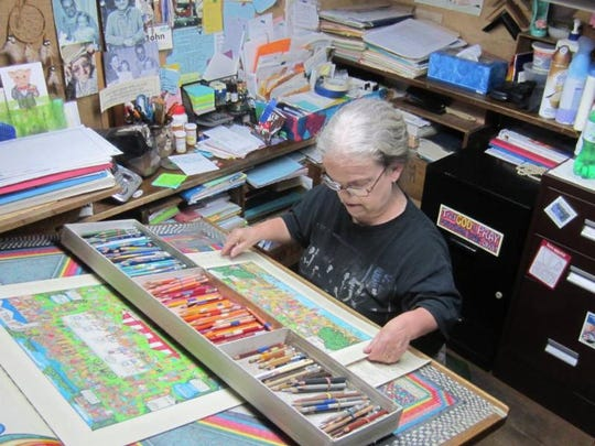 Carolyn Blattel-Britton works at her desk.