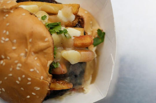 The Northern Burger from Top Bun Food Truck topped with french friens, fresh cheese curds and house gravy.