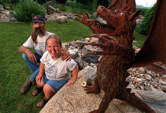 -  -RAGBRAI.CAMPGROUND.ARTISTS, 7/13/98 -- Artists Ben Britton and Carolyn Blattel-Britton are inviting RAGBRAI riders to visit their rock garden in Zearing on their way from Boone to Eldora. The garden features farm implement sculptures by Ben (like the dragon, above) as well as ponds and a rock garden peppered with flowers and other plantings. The couple will also have Carolyn's art (and RAGBRAI t-shirts designed by her) on display in the garden. REGISTER PHOTO BY SHER STONEMAN-  -Photo by: SHER STONEMAN/The Register Artists Ben Britton and Carolyn Blattel are inviting riders to visit their rock garden in Zearing on their way to Eldora today. The garden features sculptures made with farm implements, like this dragon above, made by Britton as well as ponds and a rock garden. Blattel artworks, including RAGBRAI T-shirts, will also be on display. Ran BW