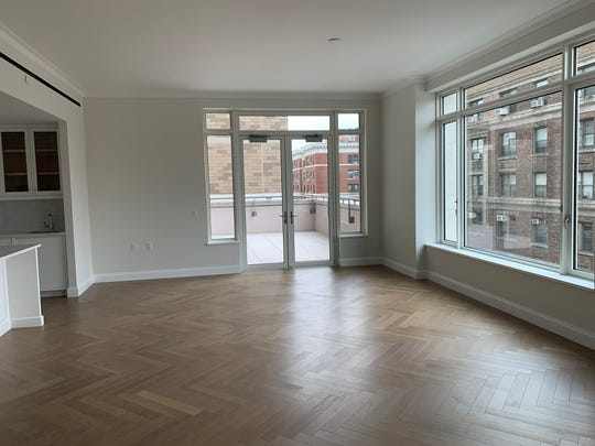 The open floor plan of a new condominium is ready for a proper furniture placement by a new owner. (Design Recipes/TNS)
