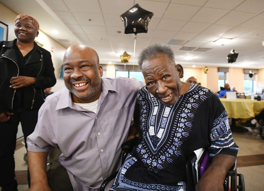 Willie Barksdale and his 70-year-old father Robert Laster chat during the 1st Annual Father's Day Ceremony at Mission Point Nursing and Physical Rehabilitation Center of Detroit in Detroit, Michigan on June 16, 2019.
