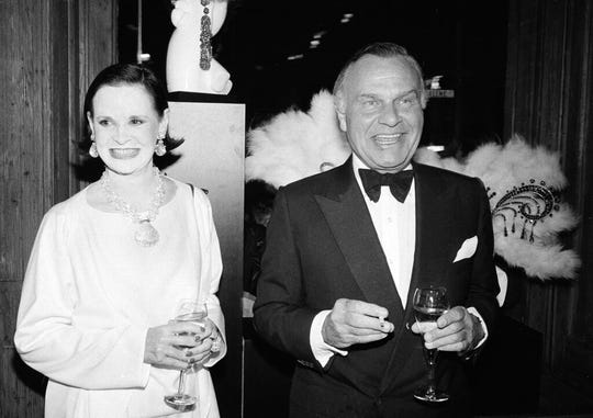 In this Nov. 9, 1982 file photo, fashion designers Gloria Vanderbilt, left, and Bill Blass are shown at the 90th birthday celebration of artist Erte in New York.
