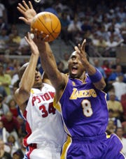Los Angeles Lakers guard Kobe Bryant tries to score during the first quarter of Game 5.