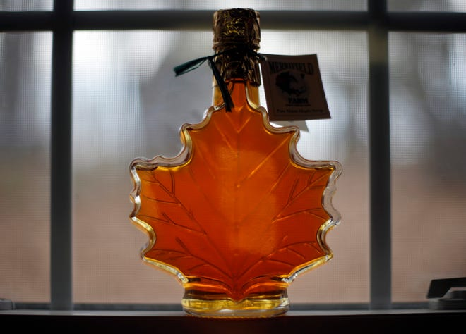 In this March 9, 2016, file photo, a bottle of maple syrup are displayed at the Merrifield Farm and Sugar Shack in Gorham, Maine.