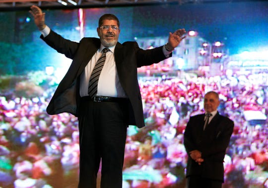 Then Muslim Brotherhood presidential candidate Mohammed Morsi holds a rally May 20, 2012, in Cairo, Egypt.