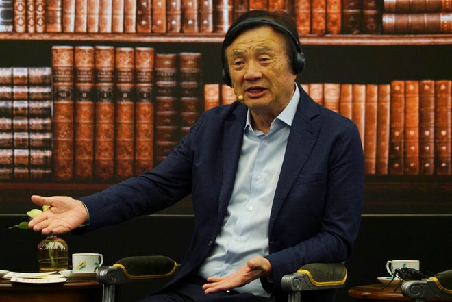 Huawei founder Ren Zhengfei speaks during a roundtable at the telecom giant's headquarters in Shenzhen in southern China on Monday, June 17, 2019. Huawei's founder has likened his company to a badly damaged plane and says revenues will be $30 billion less than forecast over the next two years.