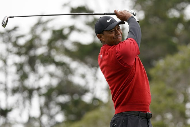 Tiger Woods watches his tee shot on the second hole during the final round of the U.S. Open.
