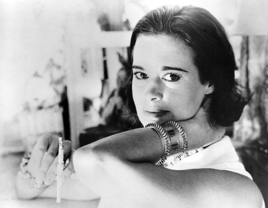 "In this Jan. 4, 1964 file photo, railroad heiress Gloria Vanderbilt poses for a photograph. Vanderbilt, the intrepid heiress, artist and romantic who began her extraordinary life as the ""poor little rich girl"" of the Great Depression, survived family tragedy and multiple marriages and reigned during the 1970s and '80s as a designer jeans pioneer, died Monday, June 17, 2019,  at the age of 95."