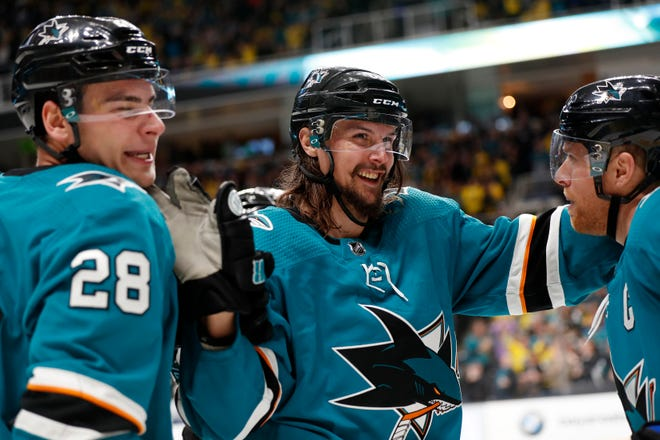 The Sharks re-signed pending free agent Erik Karlsson to an eight-year deal, turning a one-year rental into a long-term commitment to one of the league's most dynamic defensemen.