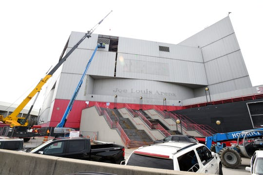 A contractor has started removing Joe Louis Arena's exterior metal panels as part of the stadium's demolition, which is expected to continue until late 2019 or early 2020.