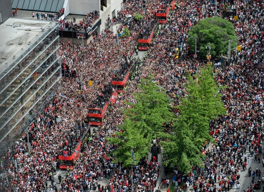 Fans cheer during the Toronto Raptors NBA basketball championship victory parade in Toronto, Monday.