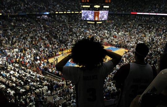 A Pistons fan wearing a Ben Wallace-like afro wig watches Game 5 between the Pistons and Lakers at The Palace.