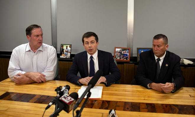 South Bend Mayor Pete Buttigieg, center, speaks during a news conference, Sunday, June 16, 2019, in South Bend, Ind., as South Bend Common Council President Tim Scott, left, and South Bend Police Chief Scott Ruszkowski, listen. Authorities say a man died after a shooting involving a police officer.