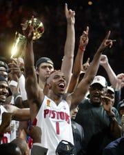 Chauncey Billups and teammates celebrate their 100-87 win over the Los Angeles Lakers for the NBA championship.